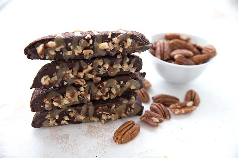A stack of keto chocolate turtle biscotti
