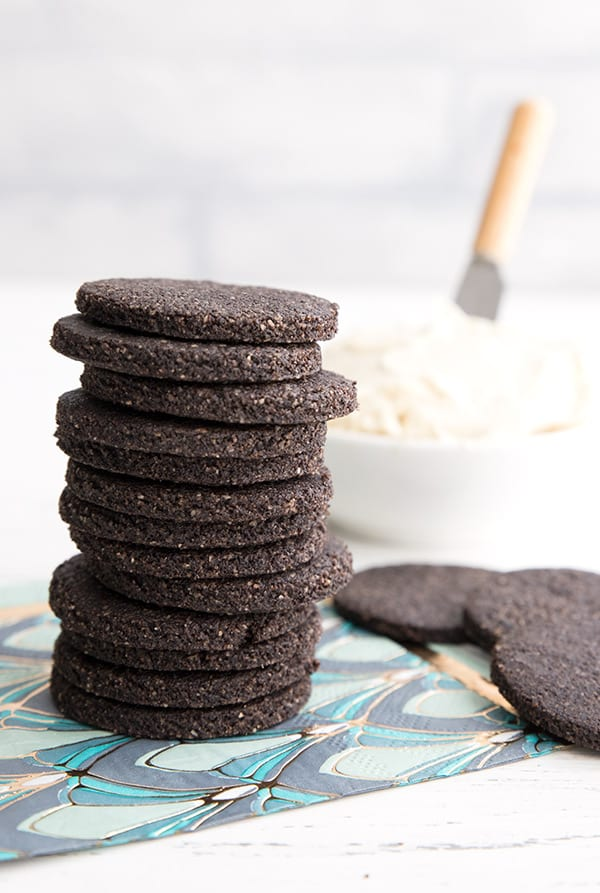 A stack of keto chocolate wafer cookies on a pattered napkin
