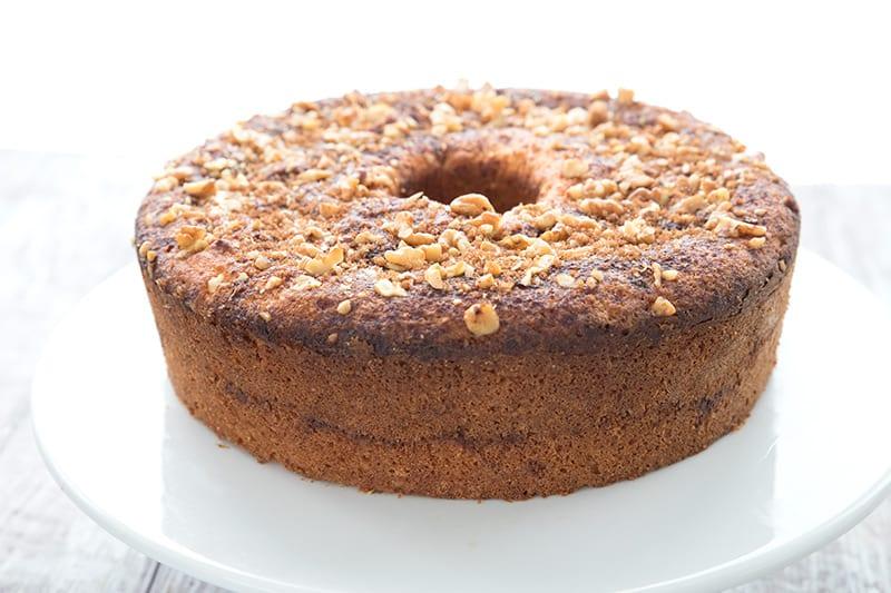 Keto Diet Explained  Keto Cinnamon Walnut coffee cake on a white cake platter