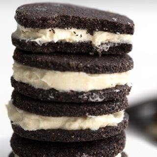 Close up shot of keto oreo cookies with a bite taken out of the top cookie
