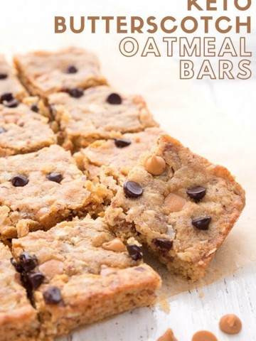 Titled image for keto butterscotch oatmeal bars. The bars are cut up on a white table with butterscotch chips around.