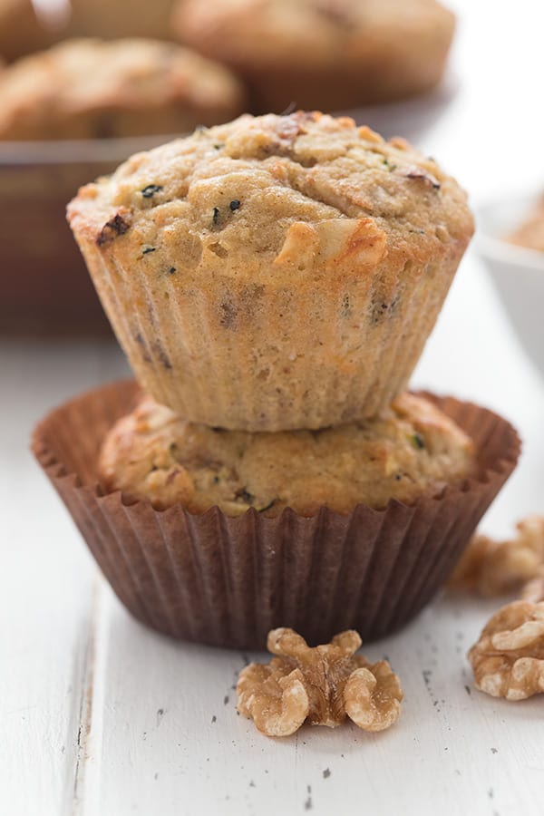 Close up shot of keto morning glory muffins with walnuts in front.