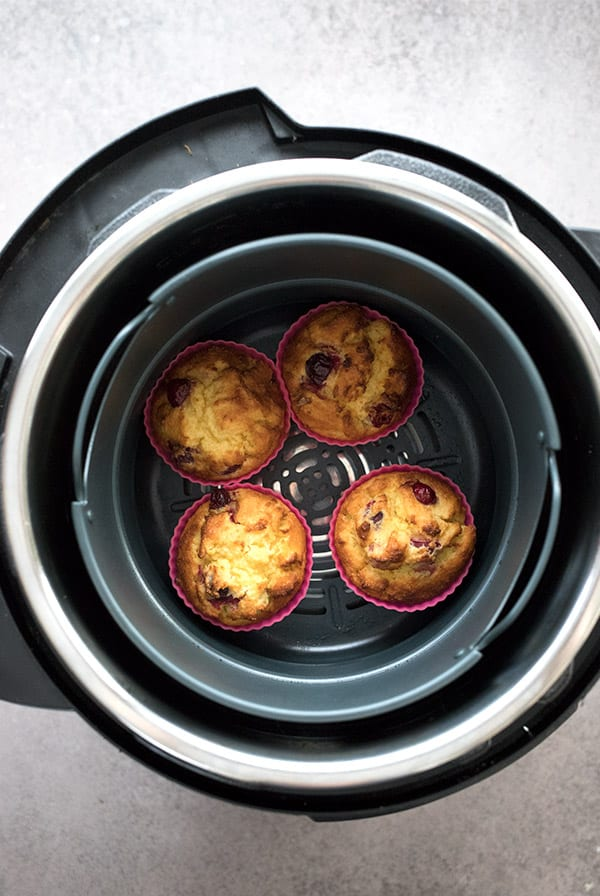 Top to bottom photo of 4 ket muffins in an air fryer.