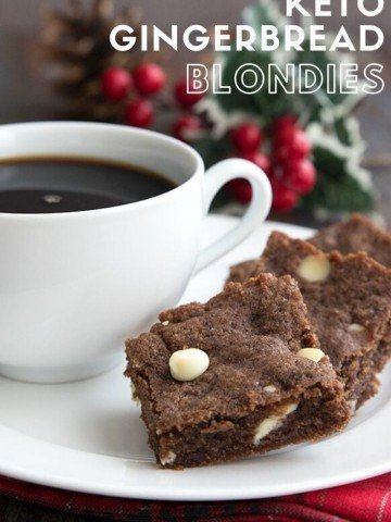 Titled image of Keto Gingerbread Blondies on a white plate beside a cup of coffee