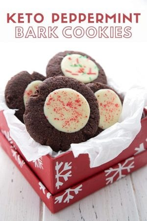 Titled image of keto peppermint bark cookies in a red gift box with white tissue paper
