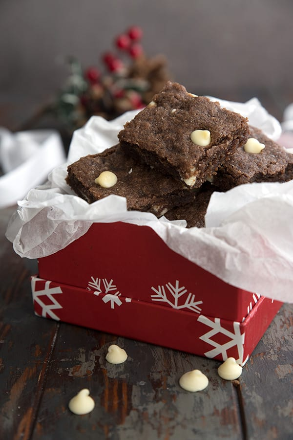Keto gingerbread blondies piled in a red holiday gift box