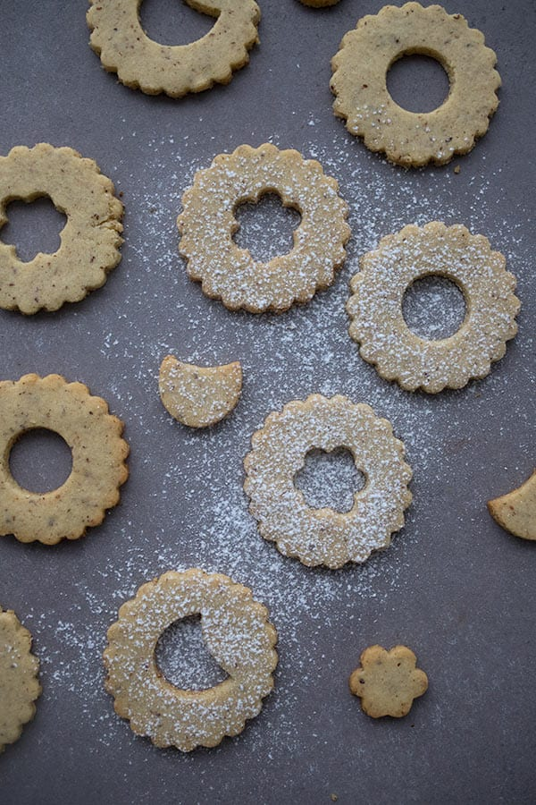 Top down photo of unfilled linzer cookies sprinkled with powdered sweetener