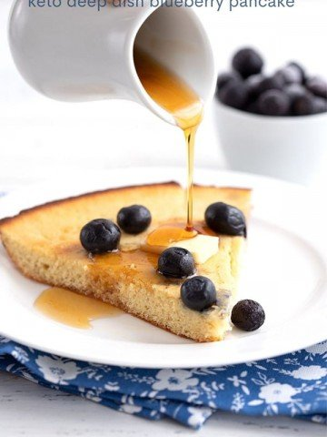 Titled image: Sugar-free pancake syrup pouring over keto blueberry pancakes.