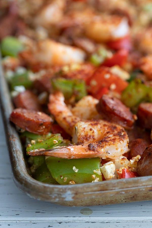 Close up shot of sheet pan keto jambalaya with a shrimp in focus