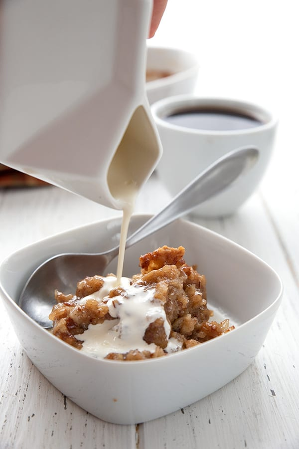 Drizzling cream over a bowl of keto oatmeal