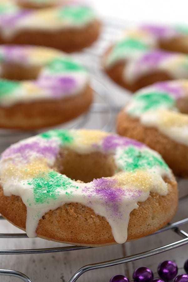 Close up shot of a keto king cake donut on a cooling rack