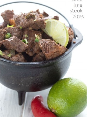 Titled image of a cast iron bowl of keto chili lime steak bites