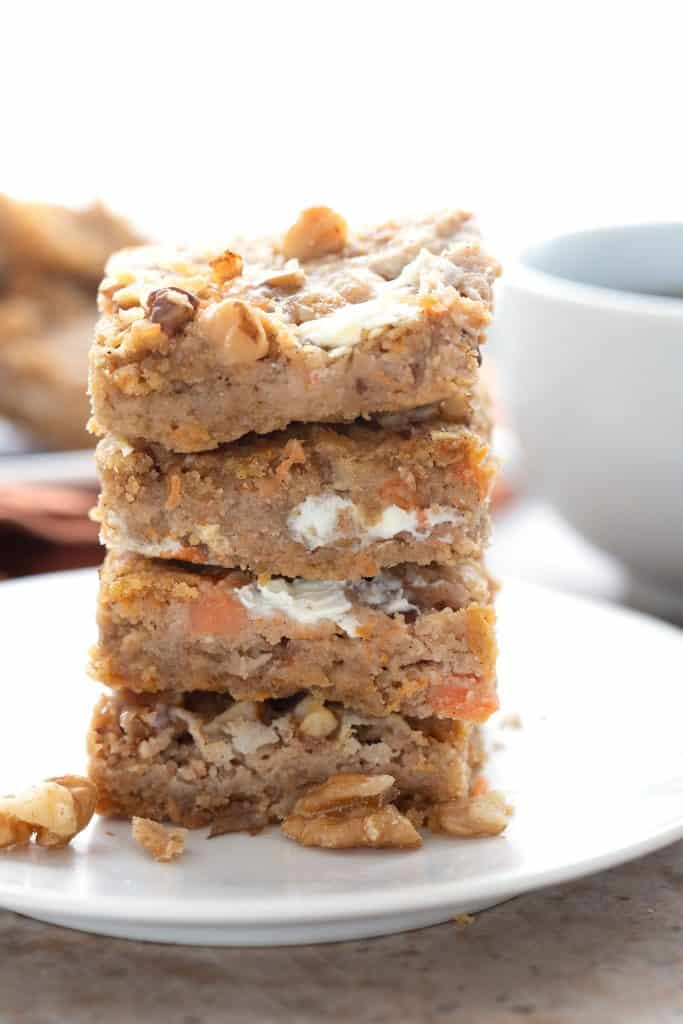 A stack of keto carrot cake bars on a white plate.