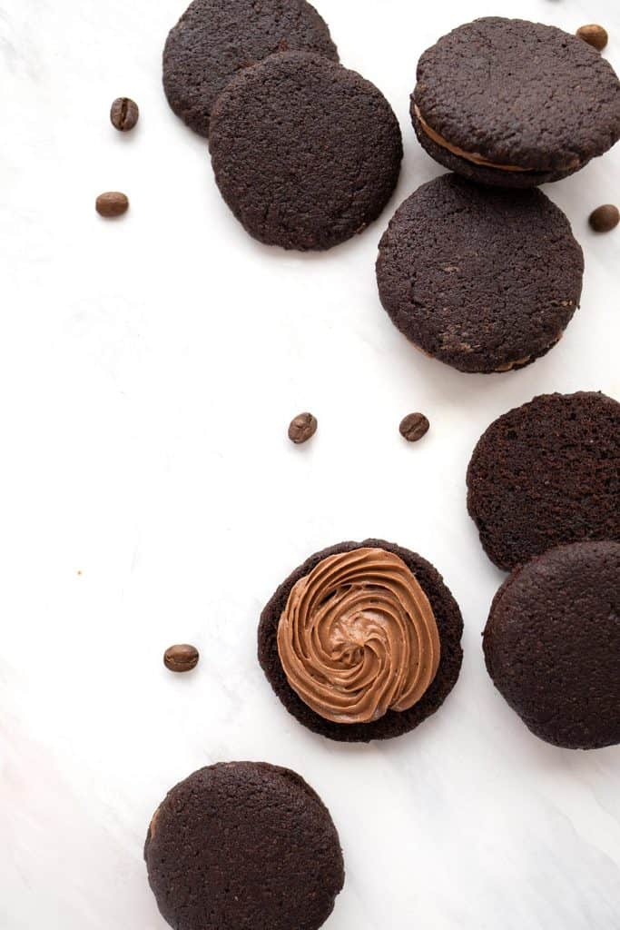 Top down image of keto chocolate espresso cookie with one open to show the filling.