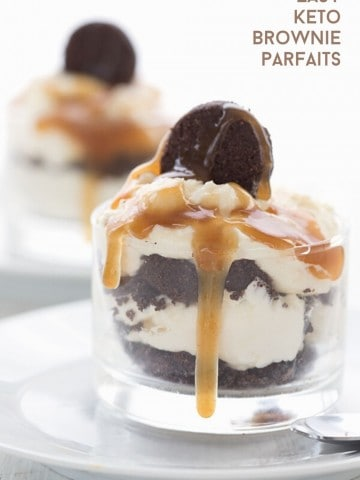 Titled image of keto brownie parfaits in glass dessert cups with sugar free caramel sauce dripping down.