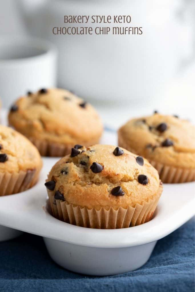 Titled image of keto chocolate chip muffins in a white tray, with a pot of coffee in the background.