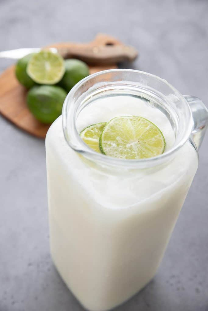 Close up shot of a pitcher full of sugar free creamy limeade.