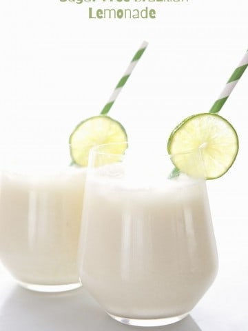 Titled image: Two glasses of Brazilian Lemonade with lime slice garnish and green striped straws on a white background.