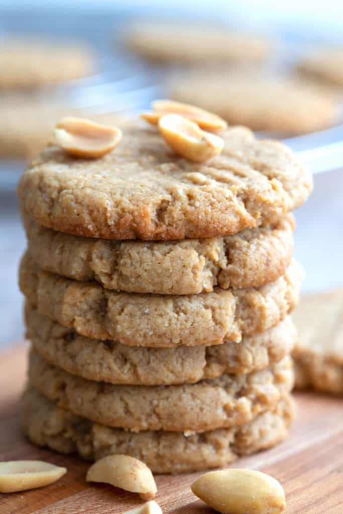 Close up shot of a stack of keto peanut butter cookies with peanuts on top.