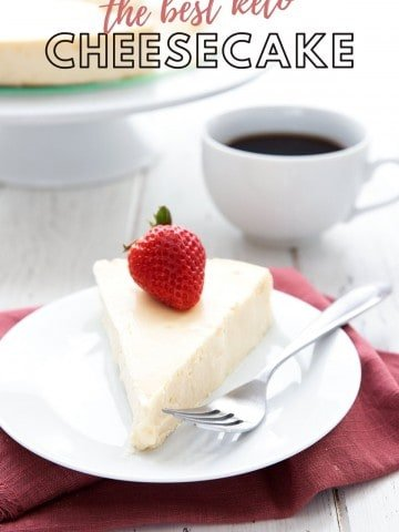 Titled image of the best keto cheesecake on a white plate over a red napkin with a cup of coffee in the background.