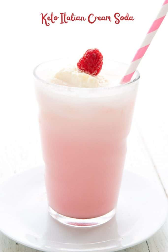 Titled image of a glass of sugar free Italian Cream Soda with a pink striped straw.