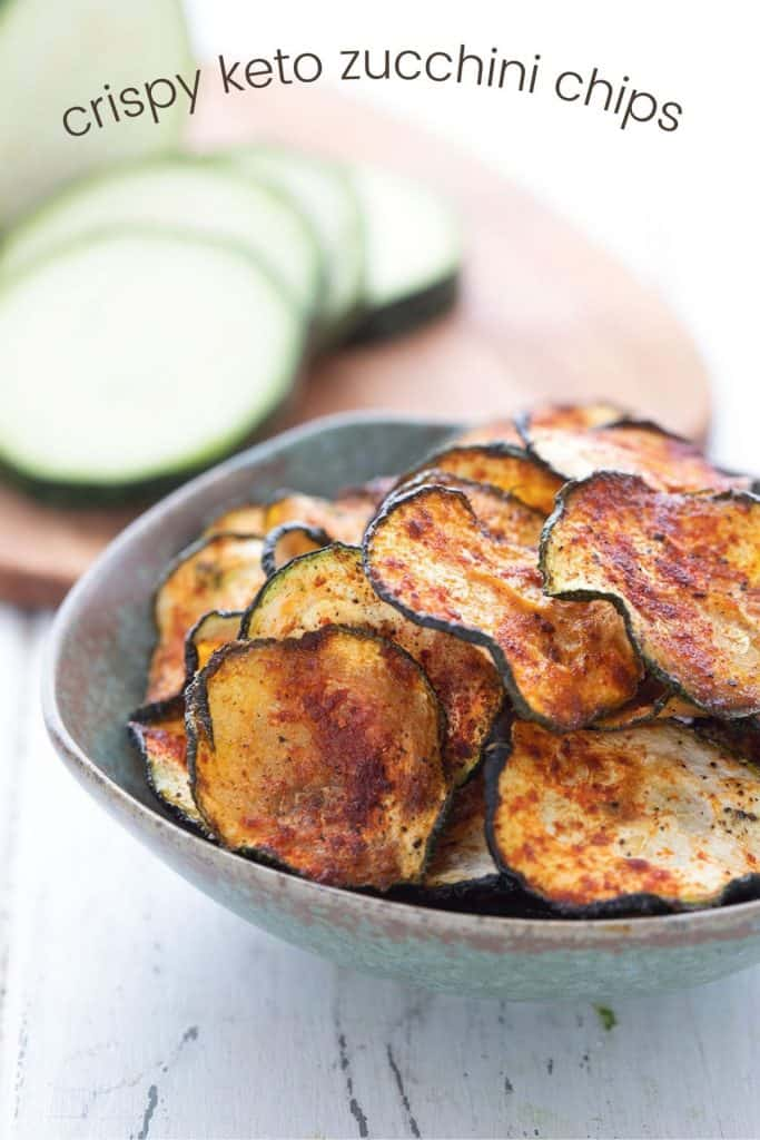 Titled image of a bowl of crispy zucchini chips with smoked paprika.
