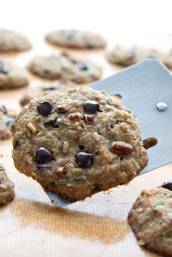 Close up shot of a spatula holding up a keto chocolate chip zucchini cookie.