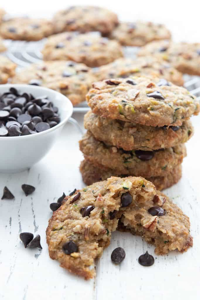 A stack of zucchini cookies with one in front, broken open.