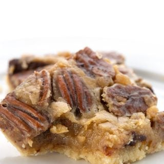 Close up shot of a keto pecan pie bar with a bite taken out of it.