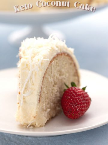 Titled image of a slice of keto coconut cake on a white plate with a strawberry.