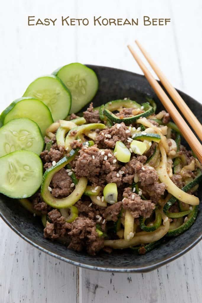 Titled image of a bowl of keto Korean beef with zucchini noodles and chopsticks on the side.
