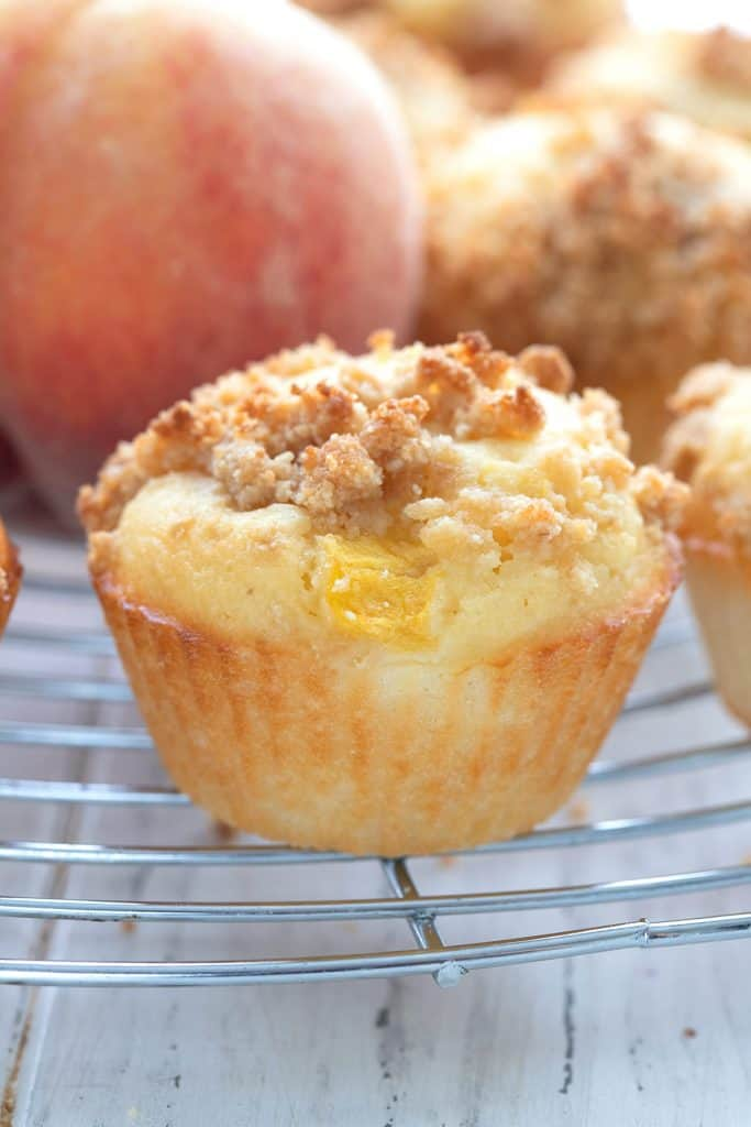 Close up shot of a keto peach muffin on a cooling rack.