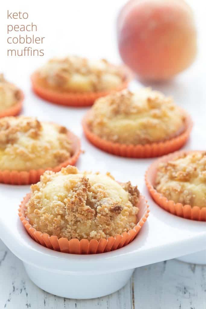 Titled image of keto peach muffins in a white ceramic muffin pan with a peach in the background.