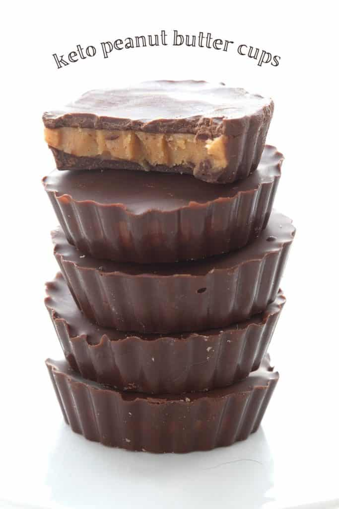 Titled image of a stack of keto peanut butter cups, and the top one has a bite taken out of it.
