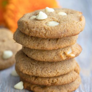 Titled image of keto pumpkin cookies with white chocolate chips in a stack.