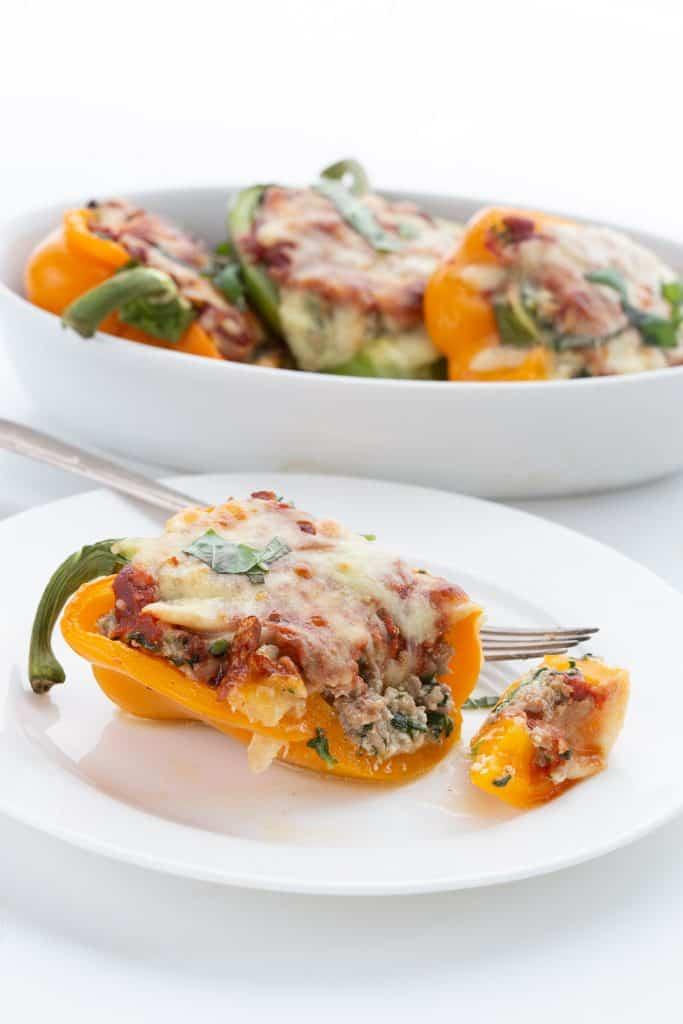 A keto lasagna stuffed pepper cut open to show the inside.