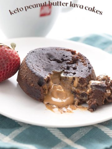 Titled image of keto chocolate peanut butter lava cake broken open to show the gooey inside.