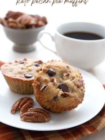 Titled image of keto pecan pie muffins on a white plate with a cup of coffee in behind.