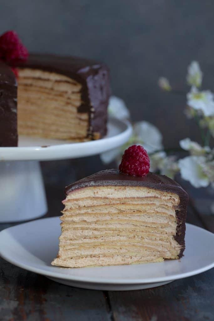 Close up shot of a slice of keto crepe cake.