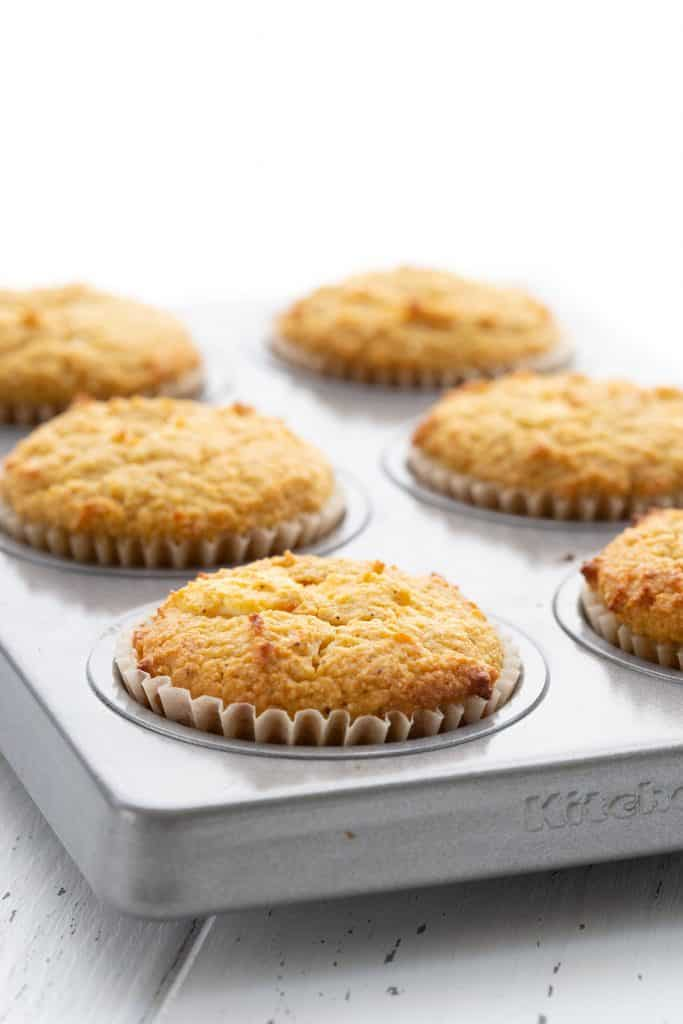 Keto Pumpkin Muffins in a muffin pan after baking.
