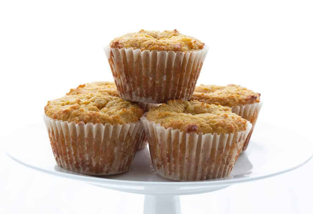 A plate full of keto pumpkin cream cheese muffins